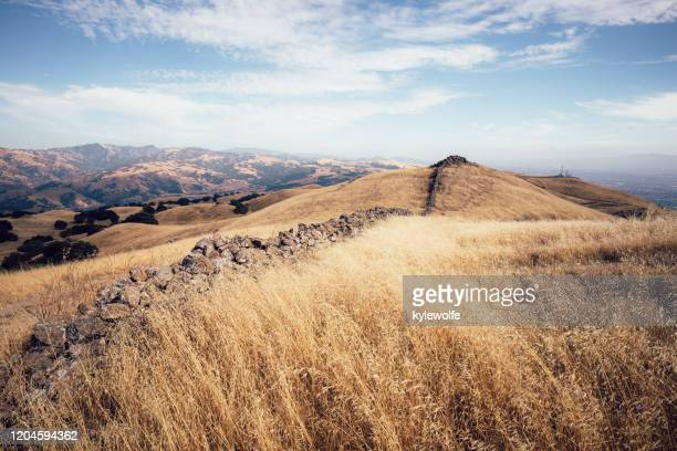 boundary wall between two park districts, mission peak, fremont, california, usa - fremont california stock pictures, royalty-free photos & images