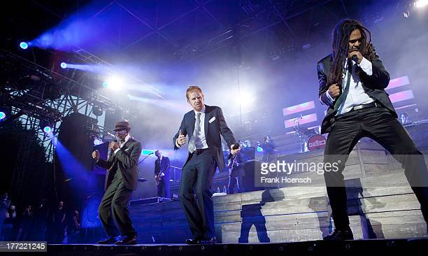 Boundzound, Peter Fox and Delle of Seeed perform live during a concert at the Kindlbuehne Wuhlheide on August 22, 2013 in Berlin, Germany.