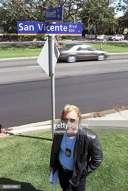 Bounty hunter Duane 'Dog' Chapman stands next to where Andrew Luster's SUV was found on San Vecente Blvd in Santa Monica after he jumped bail from...