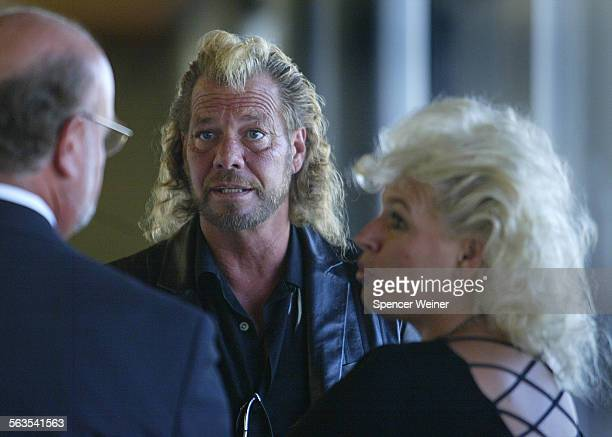 Bounty hunter Duane Lee Chapman center with his wife Beth Monday July 7 in Ventura County Superior Court Chapman is credited with tracking down...