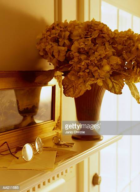 Bouquet, Glasses and Keys on a Mantel