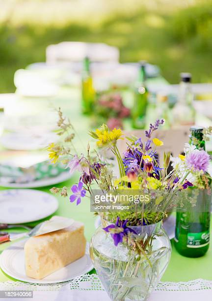 Bouquet made of wildflowers on outdoor table