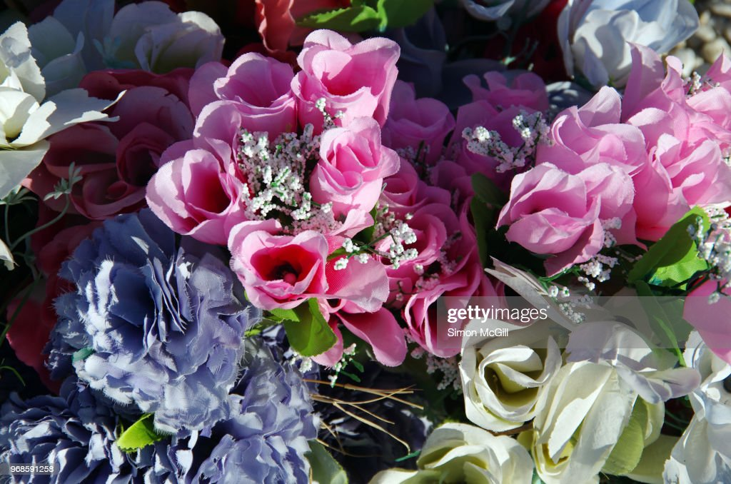 Bouquet Of Artificial Flowers On A Grave High Res Stock Photo Getty Images