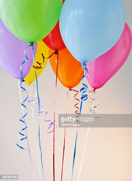 bouquet of colorful balloons - birthday balloons stock photos and pictures