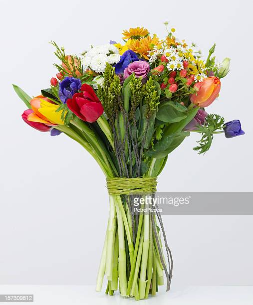 Bouquet of colorful flowers tied with green twine