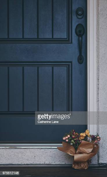 bouquet of dried roses left on doorstep of front door - soft focus stock pictures, royalty-free photos & images