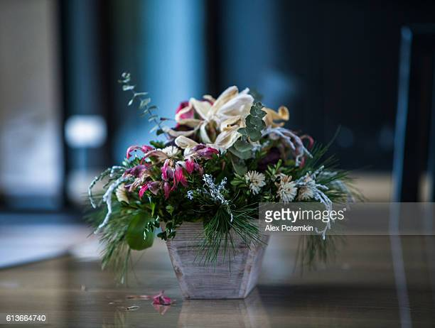 Bouquet of dry flowers in the vase on the table