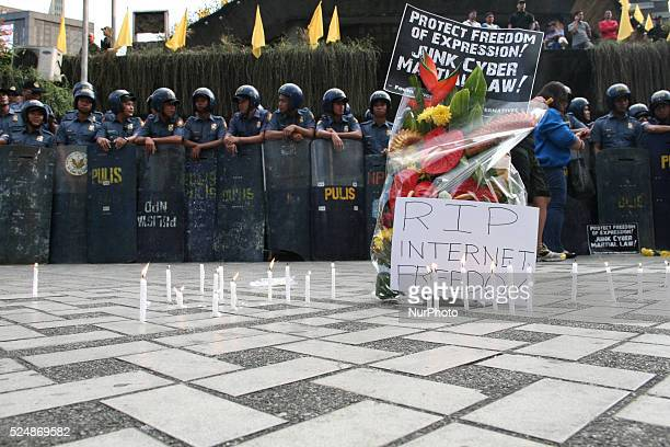 A bouquet of flowers and lighted candles were placed by the protesters infront of the Edsa Shrine during the Black Tuesday demonstration to symbolize...