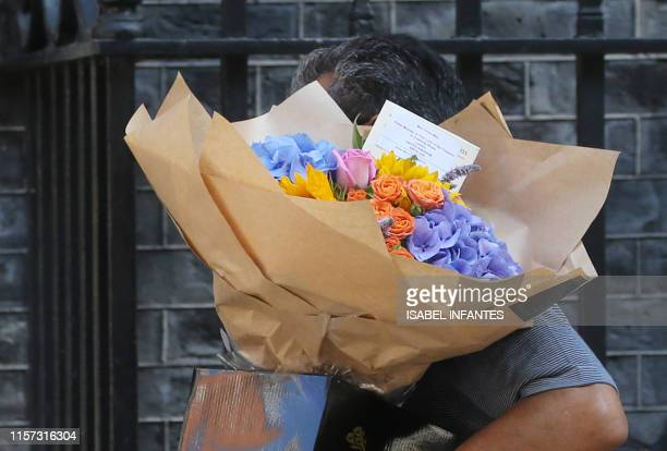 A bouquet of flowers are delivered for Britain's Prime Minister Theresa May at 10 Downing Street in central London on July 23 2019 Theresa May...