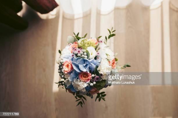 Bouquet of flowers in vase on floor