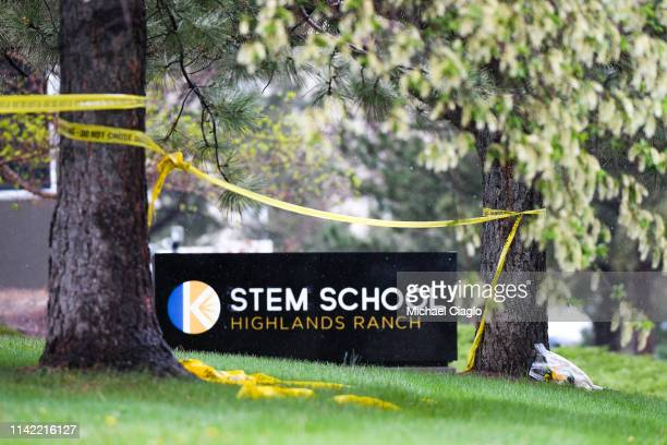 A bouquet of flowers is left next to the entrance to the STEM School Highlands Ranch on May 8 2019 in Highlands Ranch Colorado one day after two...