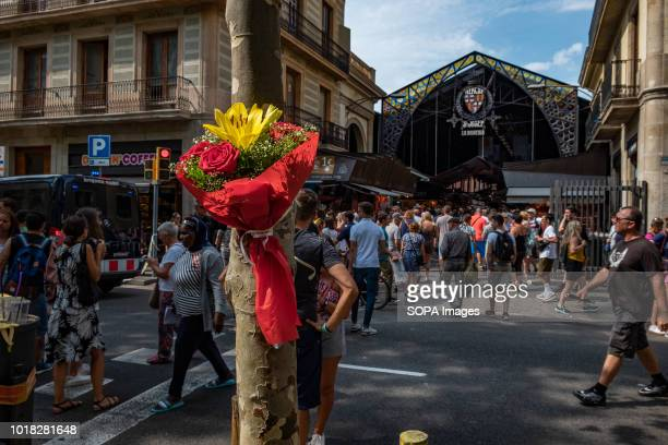 A bouquet of flowers is seen at the Ramblas in front of the traditional market of La Boquería Barcelona celebrated the first anniversary of the...