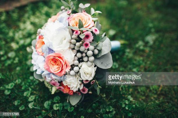 Bouquet of flowers laying in grass