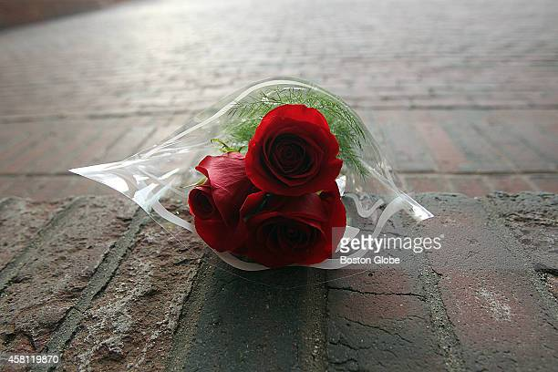 A bouquet of flowers on the steps of Boston City Hall after former Boston mayor Thomas M Menino died on October 30 2014 at age 71