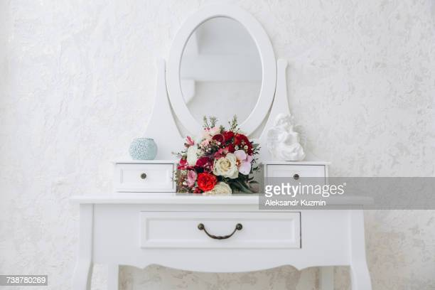 bouquet of flowers on white vanity - vanity stock pictures, royalty-free photos & images