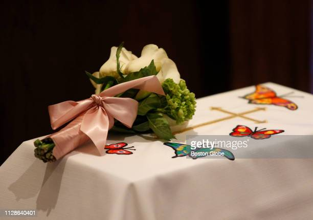 A bouquet of flowers rest atop Angela's casket during a funeral at St Anthony Shrine in Boston held by the Lazarus Ministry for the baby girl whose...