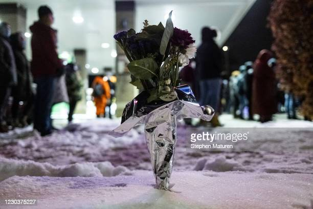 Bouquet of flowers stands in a snowbank during a vigil for Dolal Idd, who was shot and killed by Minneapolis Police last night, on December 31, 2020...