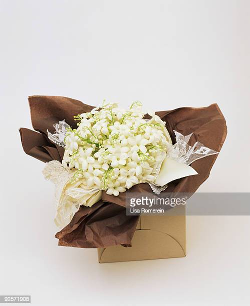Bouquet of lily of the valley in box