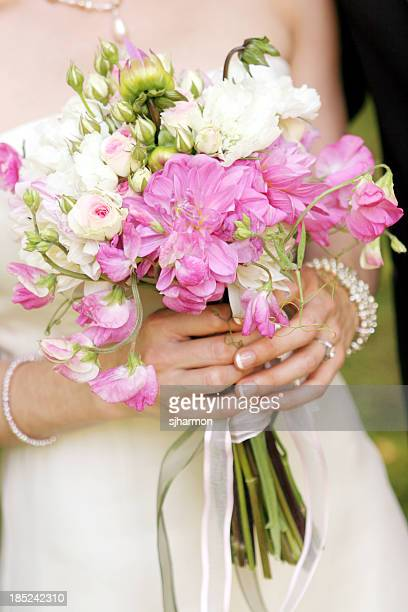 bouquet of pale pink and white flowers held by bride - long stem flowers stock pictures, royalty-free photos & images
