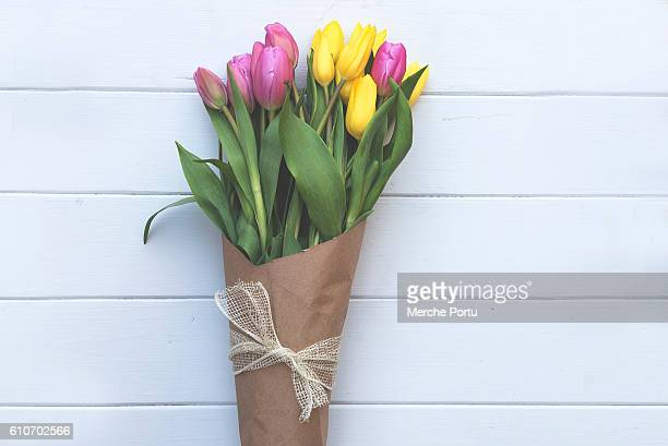 bouquet of pink and yellow tulips - bunch of flowers stock pictures, royalty-free photos & images