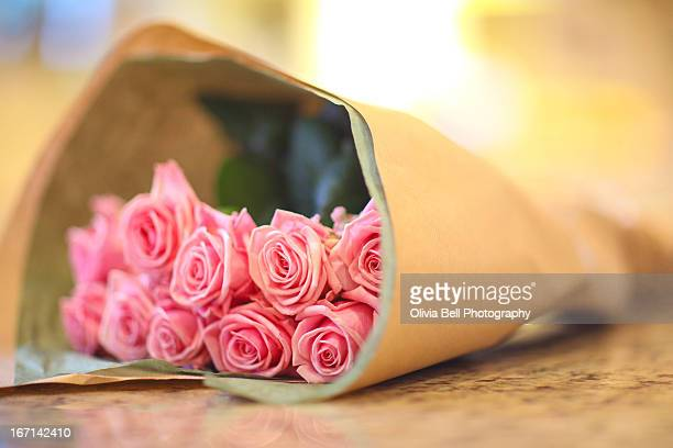 Bouquet of Pink Roses lying on kitchen surface