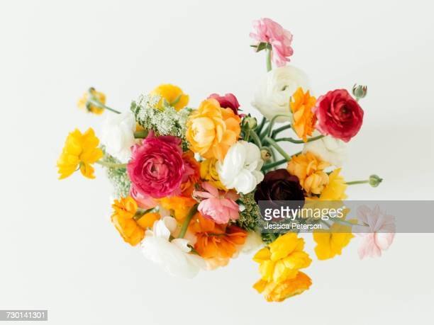 bouquet of ranunculus flowers - bouquet stock pictures, royalty-free photos & images