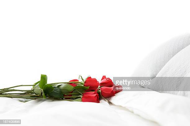 bouquet of red romantic roses on white bed, copy space - dozen stock pictures, royalty-free photos & images