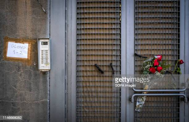 Bouquet of red roses is seen on the access door to the offices of Glovo company after the death of one of their freelance workers. Second day of...