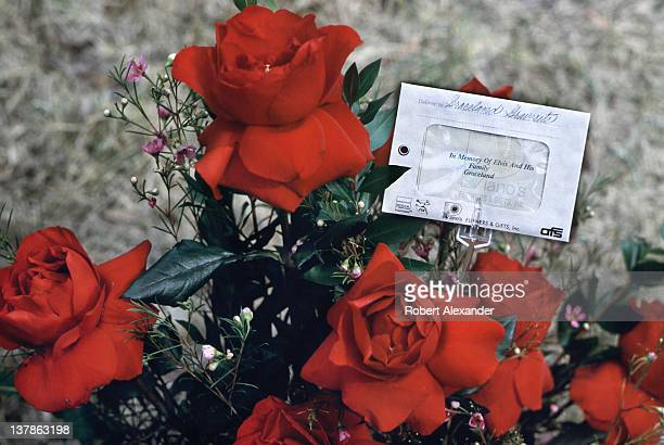 A bouquet of red roses sent by fans adorns Elvis Presley's grave at the late singer's 'Graceland' estate in Memphis Tennessee