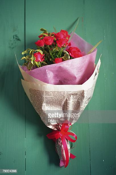 Bouquet of roses, high angle view, green background