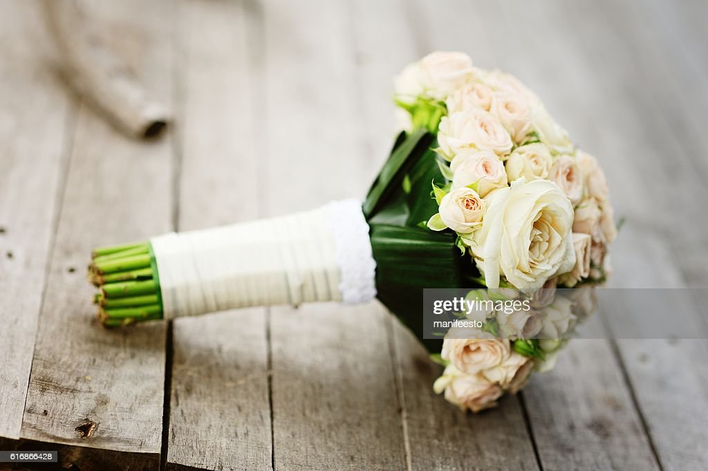 bouquet on wooden background, wedding accessory : Stock Photo