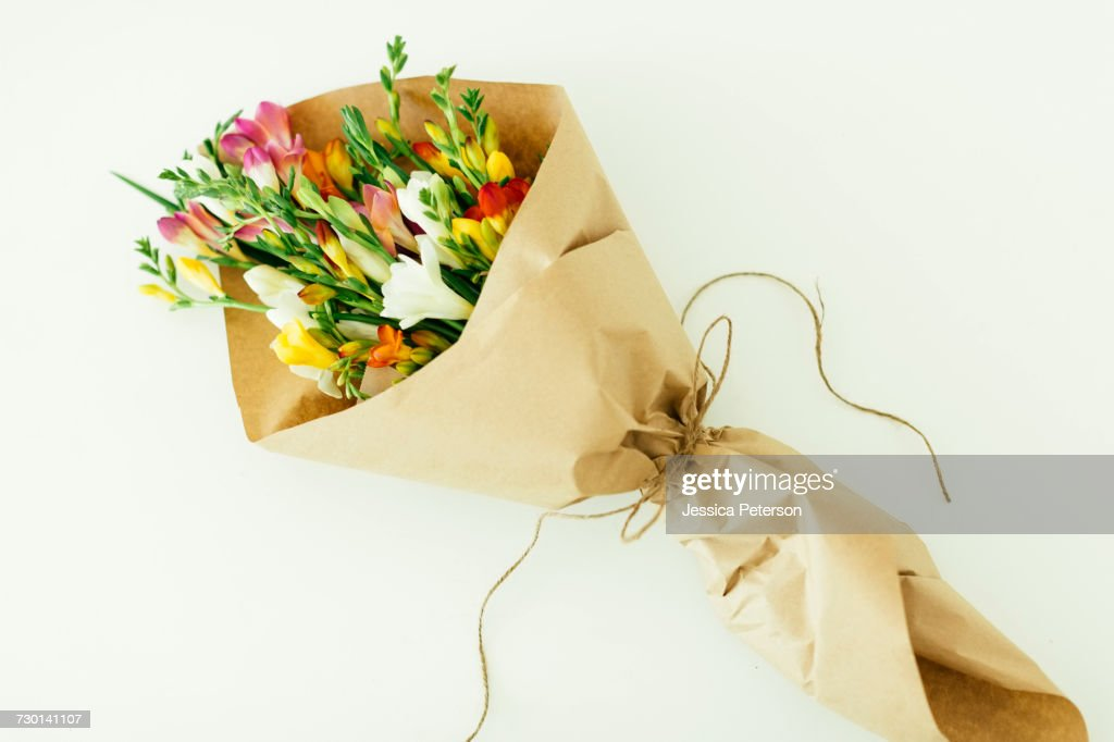 Bouquet wrapped in paper : Stock Photo