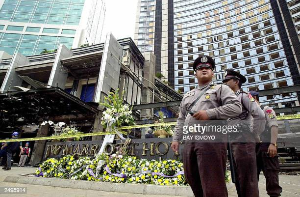 Bouquets of flowers adorn the JW Marriott hotel where Indonesian police hold a reconstruction of the bomb blast in Jakarta, 12 August 2003....