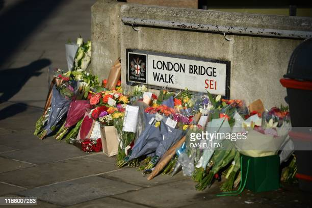 Bouquets of flowers are placed on London Bridge in memory of the victims of last weeks attack in central London on December 12, 2019. - Tributes were...