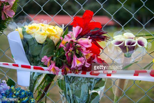 Bouquets of flowers are placed on the waterfront near White Island Tours base in Bay of Plenty december 10 2019 in memory of those who lost their...