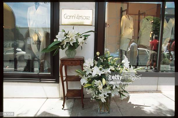 Bouquets of lilies stand outside of a Versace store after the murder of designer Gianni Versace July 15 1997 in Beverly Hills CA Versace was shot...
