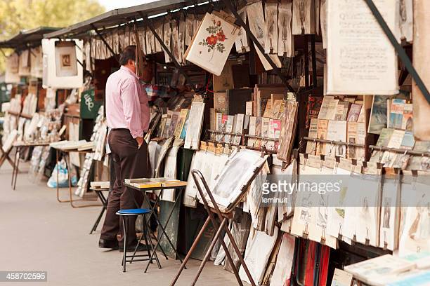 bouquinistes in paris - street market stock pictures, royalty-free photos & images