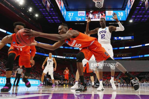 Bourama Sidibe of the Syracuse Orange attempts to rebound the ball during the second half against the TCU Horned Frogs in the first round of the 2018...