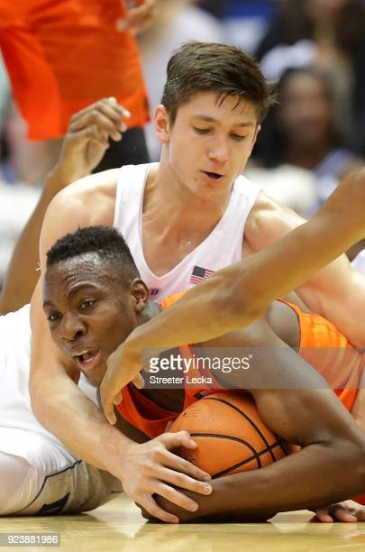 Bourama Sidibe of the Syracuse Orange battles for a loose ball against Grayson Allen of the Duke Blue Devils during their game at Cameron Indoor...