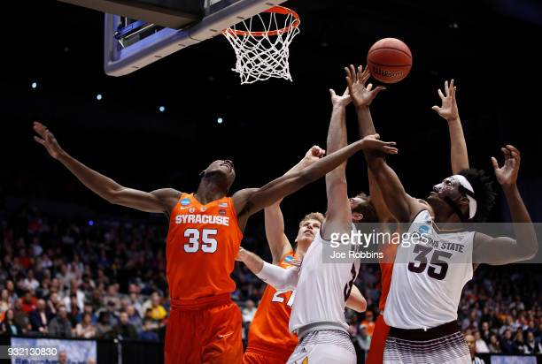 Bourama Sidibe of the Syracuse Orange battles for the ball with Mickey Mitchell and De'Quon Lake of the Arizona State Sun Devils in the first half...