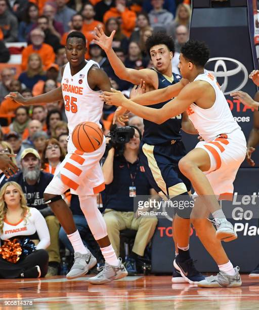Bourama Sidibe of the Syracuse Orange Kene Chukwuka of the Pittsburgh Panthers and Matthew Moyer of the Syracuse Orange react to a loose ball during...