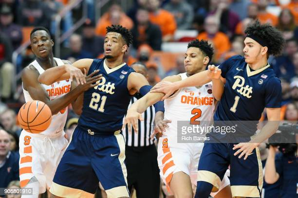 Bourama Sidibe of the Syracuse Orange Terrell Brown of the Pittsburgh Panthers Matthew Moyer of the Orange and Parker Stewart of the Panthers react...