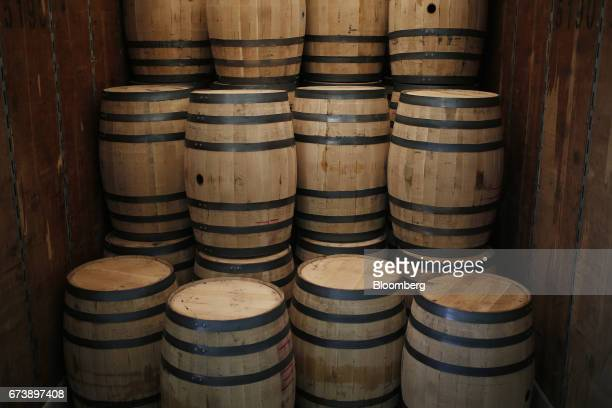 Bourbon barrels sit stacked inside a semi trailer after being manufactured at the BrownForman Corp cooperage facility in Louisville Kentucky US on...