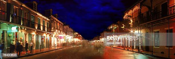 bourbon street at night, new orleans - new orleans mardi gras stock photos and pictures