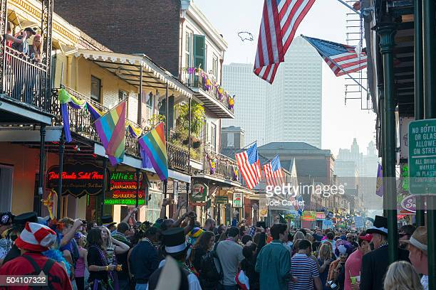 bourbon street crowd during mardi gras - new orleans french quarter stock photos and pictures