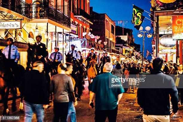 bourbon street crowd - mardi gras in new orleans. - mardi gras new orleans stock photos and pictures