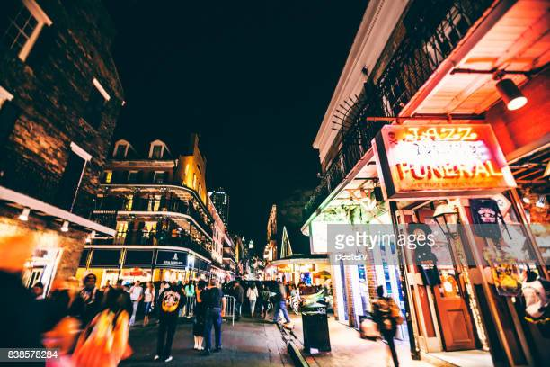 bourbon street crowd - new orleans, louisiana - new orleans french quarter stock photos and pictures