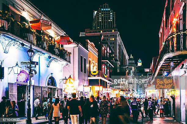 bourbon street crowd. - mardi gras new orleans stock photos and pictures
