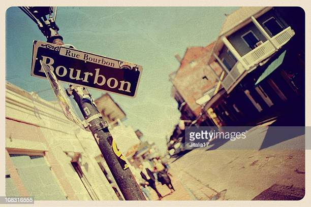 bourbon street, new orleans - vintage postcard - new orleans stock pictures, royalty-free photos & images