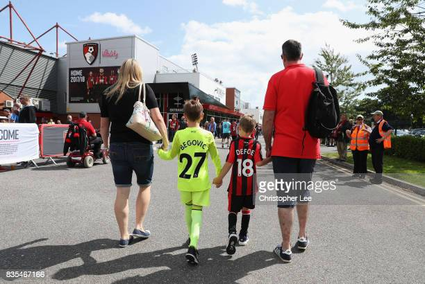 Bourfnemouth fans make their way to the stadium prior to the Premier League match between AFC Bournemouth and Watford at Vitality Stadium on August...